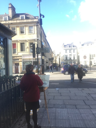 woman painting the Abbey in Bath (so cool to see someone on the side painting something so beautiful)
