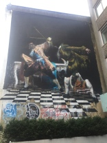 part of the art/graffiti festival in Bristol (artist was Irish, you can see the colors of the Ireland flag [green, white and orange] below the gentleman on the right and colors of the British flag on the gentleman to the left; a Irishman fighting a Brit and winning)